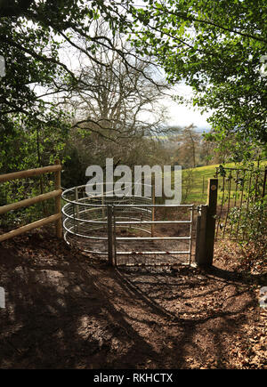 Metal gate on a public footpath in the English countryside. - Stock Photo