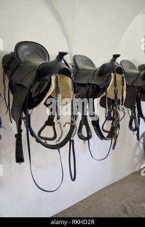Leather saddle horse, retro style on wall. - Stock Photo
