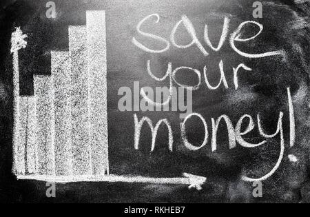 Handwritten Message On A School Chalkboard Income Concept Save Your Money And Graph Shows The Increase Of The Target. - Stock Photo
