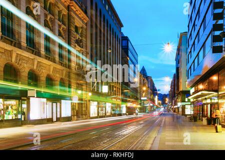 Helsinki, Finland. Tram Departs From A Stop On Street Aleksanterinkatu In Helsinki. Night View Of Aleksanterinkatu Street In Kluuvi District In - Stock Photo