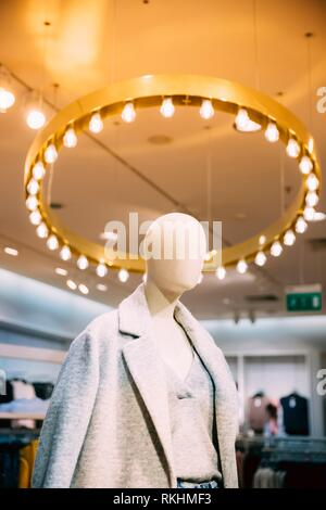 Close View Of Mannequin Dressed In Female Woman Casual Clothes In Store Of Shopping Center. - Stock Photo