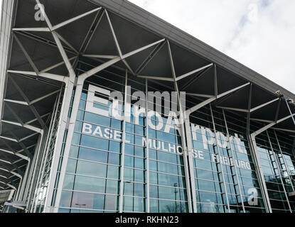 BASEL, SWITZERLAND - MAR 22, 2018: Basel Mulhouse Freiburg EuroAirport glass facade - wide angle view with big text printed on the glass - Stock Photo