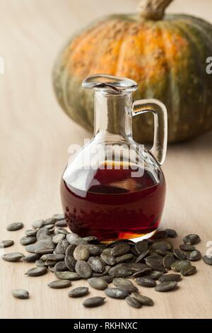 Bottle with tasty pumpkin seed oil and roasted seeds. - Stock Photo