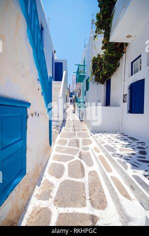 Mykonos, Greece. Whitewashed dotted alley in old city, Greek Islands. - Stock Photo