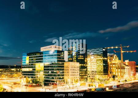 Oslo, Norway. The Night Panoramic View Of Contemporary District Of Black And White High-Rised Buildings In The Center Of City In Bright Illumination - Stock Photo