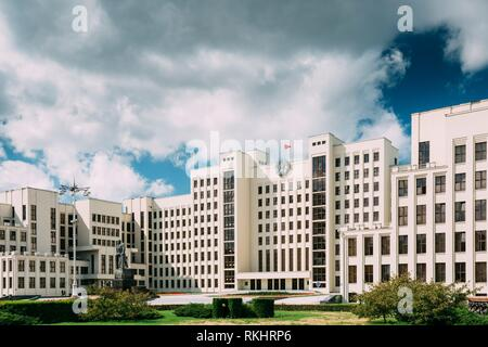 Minsk, Belarus. White Government Parliament Building Or National Assembly Of Belarus In Independence Square. Sunny Summer Day. Soviet Landmark. - Stock Photo