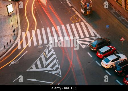 Prague, Czech Republic. Top View Of Road Marking A Pedestrian Crossing And Parked Cars On The Hybernska Street. Light Traffic Trails. - Stock Photo