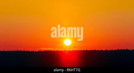 Panorama. Sun Over Horizon, Sunset, Sunrise Background. Sunset Over Dark Ground Forest. Panorama. - Stock Photo