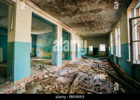 The Ruined Hall Of Abandoned Rural School After Chernobyl Disaster In Evacuation Zone. The Terrible Consequences Of The Nuclear Pollution Twenty - Stock Photo