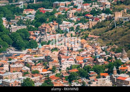 Tbilisi Georgia. Aerial View Of Old Town Buildings And Narikala Ancient Fortress, Famous Landmark In Sunny Summer Day. - Stock Photo