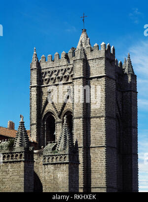 Spain, Castile and Leon, Avila. Cathedral of St. Salvador. Catholic church. Its construction was started in the 12th century in Romanesque style and concluded in the 14th century in Gothic style. Architectural detail. Bell tower. - Stock Photo