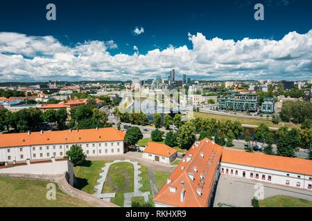 Vilnius, Lithuania. Modern City And Part Of Old Town Under Dramatic Sky In Summer Day. Behind New Arsenal At Northern Foot Of Castle Hill, One Can - Stock Photo