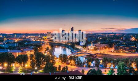 Vilnius, Lithuania, Eastern Europe. Modern Office Buildings Skyscrapers In Business District New City Center Shnipishkes In Night Illuminations. - Stock Photo