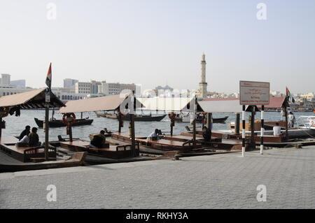 A fleet of moored water taxis on the Dubai Creek in Dubai in the United Arab Emirates, (UAE). - Stock Photo