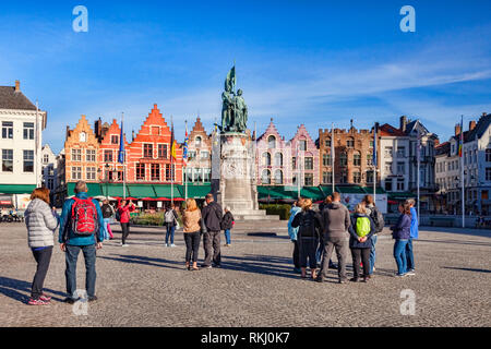 25 September 2018: Bruges, Belgium - Tourists in the Market Square on a sunny afternoon. - Stock Photo