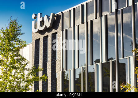 2 November 2018: Salford Quays, Manchester, UK - ITV building with logo, beautiful autumn day with clear blue sky, bright foliage. - Stock Photo