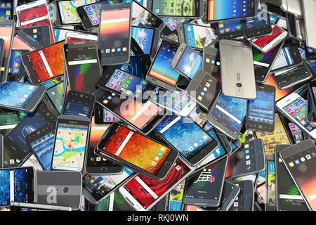 Choose mobile phone. Heap of the different smartphones with different application on the screen. Modern technology concept background. 3d - Stock Photo
