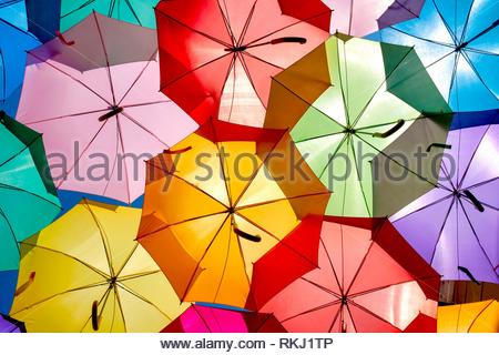 Close up of some colorful umbrellas hanging in Agueda, Portugal. - Stock Photo