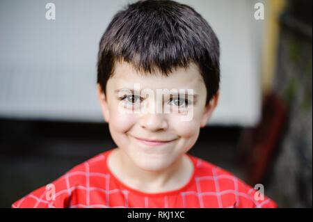 portrait of 10 year old boy with spiderman suit. - Stock Photo