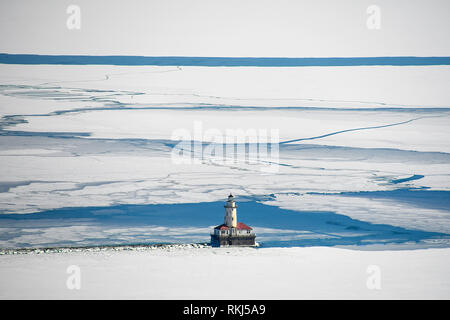 aerial view of Chicago lighthouse on Lake Michigan in ice and snow - Stock Photo