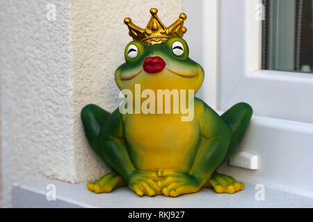 Figurine of the Frog Princess / Decorative Frog on the windowsill - Stock Photo