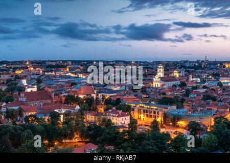 Vilnius, Lithuania. Historic Center Cityscape At Blue Hour After Sunset. Old Town Under Evening Dusk Sky. Travel Panorama In Night Illuminations. - Stock Photo