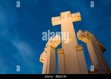 Vilnius, Lithuania. Famous White Monument Three Crosses On The Bleak Hill In Lighting In Evening Or Night Illumination. Bottom View. - Stock Photo