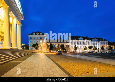 Vilnius, Lithuania. The Evening View Of Didzioji Street With Old Architecture And The Columns Of City Council Administrative Building In Bright - Stock Photo