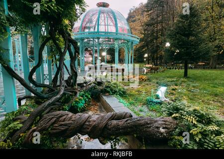 Borjomi, Samtskhe-Javakheti, Georgia. Pavilion Above Hot Spring Of Borjomi Mineral Water. Famous Local Landmark Is City Park At Autumn October - Stock Photo