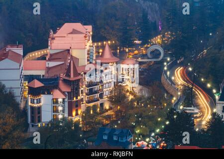 Borjomi, Samtskhe-Javakheti, Georgia. Aerial View Borjomi Hotel House At Autumn October Evening Night In Night Illuminations Lights Lighting. - Stock Photo