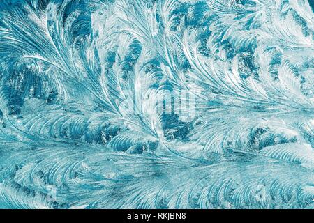Blue Frosty Glass Ice Background, Natural Beautiful Snowflakes Frost Ice Pattern. Winter Xmas Christmas Abstract Backdrop, Background Or Texture. - Stock Photo