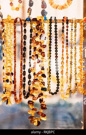 Variety Of Beads Made Of Amber. Jewellery Made Of Amber. Traditional Souvenirs At European Market. Souvenir From Baltic Countries, Europe. - Stock Photo