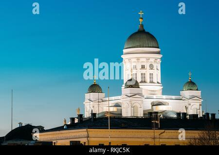 Helsinki, Finland. Famous Landmark Is Lutheran Cathedral In Night Evening Lighting. - Stock Photo