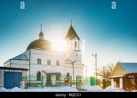 Gomel, Belarus. Sun Shining Over Church Of St Nicholas The Wonderworker In Sunny Winter Day. Orthodox Church Of St. Nikolay Chudotvorets At Sunset Or - Stock Photo