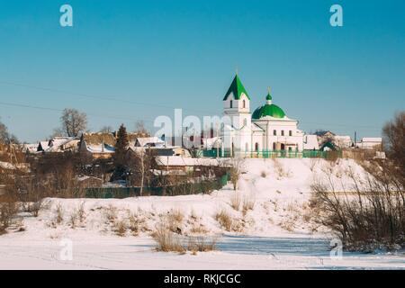 Gomel, Belarus. Church Of St Nicholas The Wonderworker And Frozen Sozh River In Sunny Winter Day. Orthodox Church Of St. Nikolay Chudotvorets. - Stock Photo