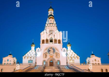 Minsk, Belarus. Night View Of All Saints Church. Minsk Memorial Church In Memory Of The Victims, Which Served As Our National Salvation. Evening - Stock Photo