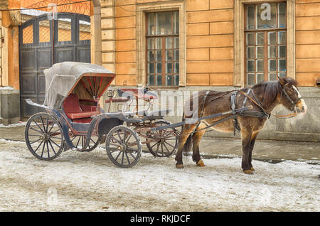 Horse-drawn sleigh waiting for passengers.A kind of taxi in the old days. - Stock Photo