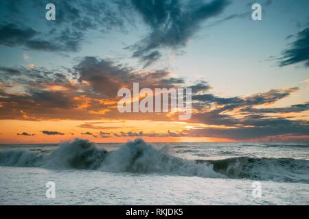 Sea Or Ocean Waves During Storm Colorful Sunset Or Sunrise Sky Background. - Stock Photo