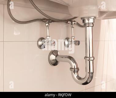 Basin siphon or sink drain in a bathroom, clean. - Stock Photo