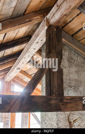Wooden contruction on an old house in Austria. - Stock Photo