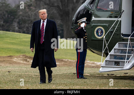 US President Donald Trump arrives on the South Lawn of the White House aboard Marine One in Washington, DC after a trip to Dover, Delaware where he visited with the families of 4 Americans killed in Syria on January 19, 2019. - Stock Photo