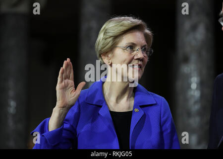 US Senator Elizabeth Warren, Democrat of Massachusetts, is sworn in by Vice President Mike Pence on Capitol Hill in Washington, DC on January 3, 2019. - Stock Photo