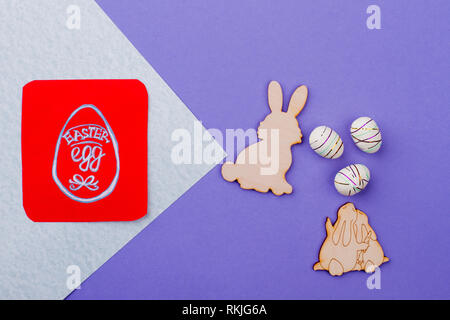 Plywood rabbit cutouts and eggs. - Stock Photo