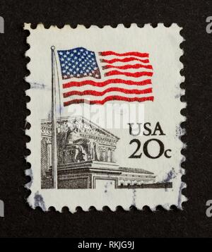 USA - CIRCA 1975: Stamp printed in the USA shows the Stars and Stripes, circa 1975. - Stock Photo