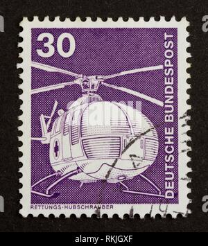 GERMANY - CIRCA 1980: Stamp printed in Germany shows an helicopter, circa 1980. - Stock Photo