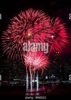 New York, USA. 11th Feb, 2019. Fireworks are displayed above the Hudson River in New York, the United States, on Feb. 11, 2019, to celebrate the Chinese lunar New Year. Credit: Wang Ying/Xinhua/Alamy Live News - Stock Photo