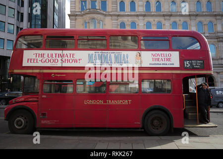 London, UK. 11th February 2019. Heritage Routemaster red bus with conductor, still operates daily between Trafalgar Square and the Tower of London, until the 1st of March this year, when the bus will run only on weekends. Credit: Joe Kuis / Alamy Live News - Stock Photo