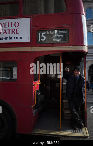 London, UK. 11th February 2019. Open platform at the rear of the heritage Routemaster red bus with conductor, still operating daily between Trafalgar Square and the Tower of London, until the 1st of March this year, when the bus will run only on weekends. Credit: Joe Kuis / Alamy Live News - Stock Photo