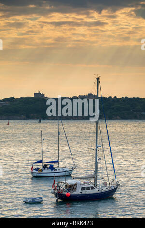 Boats moored in the Carrack Roads captured from neat St Anthony Lightouhse. - Stock Photo