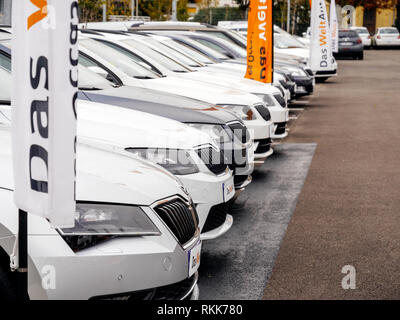 Strasbourg, France - Nov 7 2017: Perspective view - rows of new cars for sale large stock in wide parking lot - Czech Skoda car dealer inventory - Stock Photo